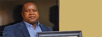Dr. John M. Mutua (Ph.D. Economics)